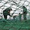 MIKE SPRINGER/Staff photo<br /> Crew members of the Captain Joe fishing trawler mend their net Monday on the Jodrey State Fish Pier in Gloucester as they prepared to go back out to sea. From left are Sal Carollo of Gloucester and Michael Irving, Kenny Fields and Chris Callow, all of Portland, Maine.<br /> 4/30/2018