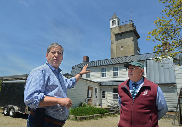 MIKE SPRINGER/Staff photo<br /> State Senator Bruce Tarr speaks during a tour Friday of the observation tower at Halilbut Point State Park guided by Leo Roy, right, commissioner of the state Department of Conservation and Recreation, in Rockport. The tower is being renovated and is should reopen next spring.<br /> 5/25/2018