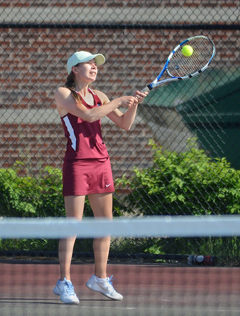 MIKE SPRINGER/Staff photo<br /> Lexi Zubricki, Gloucester's number two singles player, hits a backhand during varsity tennis play Tuesday against Beverly in Gloucester.<br /> 5/29/2018