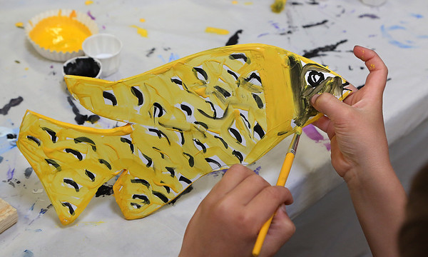 MIKE SPRINGER/Staff photo<br /> Second-grader Treyton Bushfield paints a fish at East Gloucester school.<br /> 5/11/2018
