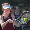 MIKE SPRINGER/Staff photo<br /> Christina Jones, Gloucester's number one singles player, hits a backhand during varsity tennis play Tuesday against Beverly in Gloucester.<br /> 5/29/2018