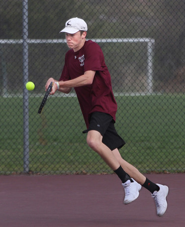 MIKE SPRINGER/Staff photo<br /> Rockport's Hayden Beaton competes in singles against a North Reading player during varsity boys tennis Wednesday in Rockport.<br /> 5/9/2018