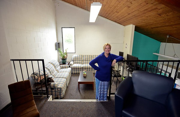 RYAN HUTTON/ Staff photo<br /> Nancy Marrs, Pass Program Director for the Greater Beverly YMCA, stands in the McPherson Youth Center's upstairs study room on Tuesday. [[MER1805221508393745]]