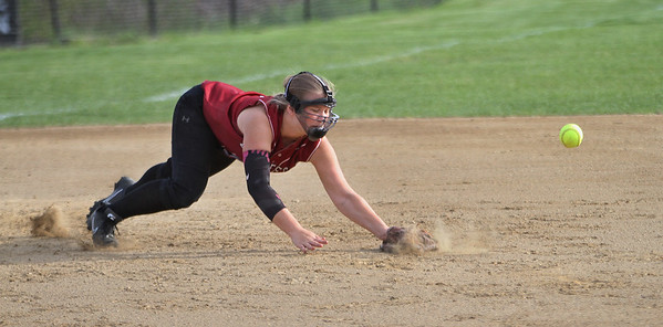 MIKE SPRINGER/Staff photo<br /> A line drive passes Gloucester third baseman Marisa Orlando during varsity softball play against Marblehead Friday in Gloucester.<br /> 5/11/2018
