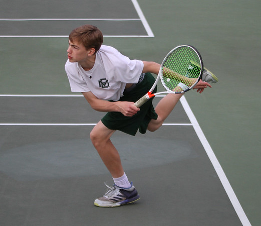 MIKE SPRINGER/Staff photo<br /> Pieter Breuker, the top-ranked singles player for Manchester Essex, competes Thursday with a Swampscott player during varsity tennis in Manchester.<br /> 5/10/2018