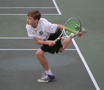 MIKE SPRINGER/Staff photo Pieter Breuker, the top-ranked singles player for Manchester Essex, competes Thursday with a Swampscott player during varsity tennis in Manchester. 5/10/2018