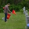 Firefighters place flags on graves for Memorial Day