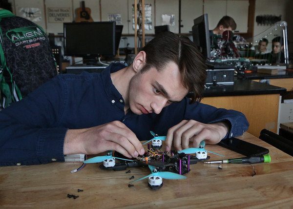 MIKE SPRINGER/Staff photo<br /> Aiden Cunha, a junior, assembles a quadrocopter drone Wednesday in Kurt Lichtenwald's engineering class at Gloucester High School.<br /> 5/9/2018