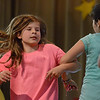 "MIKE SPRINGER/Staff photo<br /> Fourth-grader Lila Barry, left, dances with classmate Sofia Crivello during special performance of ""School House Rock Jr."" for fellow students Friday at Veterans Memorial Elementary School in Gloucester. The musical was presented to the public Wednesday and Thursday nights.<br /> 5/25/2018"