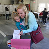 MIKE SPRINGER/Staff photo<br /> Betsy McKeen casts her vote in the town election Monday with the help of her daughter Molly, 4, at the Essex Fire Station.<br /> 5/14/2018