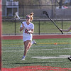 MIKE SPRINGER/Staff photo<br /> Gloucester's Gabbie Machado drives the ball upfield Tuesday against Malden during varsity lacrosse play in Gloucester.<br /> 5/8/2018