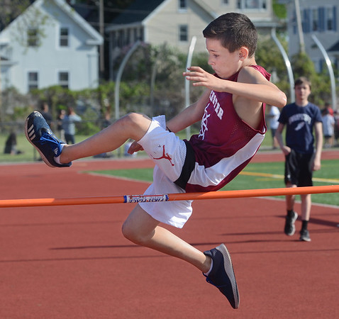 MIKE SPRINGER/Staff photo<br /> Seventh-grader Michael Calomo of Gloucester competes in the high jump in the Northeastern Conference middle school track meet Wednesday at Newell Stadium in Gloucester.<br /> 5/23/2018