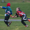 Desi Smith/Staff Photo.     Kai Rich (right) of the Gloucester U-8 Chiefs grabs the flag from the belt of a Marblehead player during the North Shore Flag Football Tournament of Champions Sunday morning at the O'Maley Middle School football field.  November 22,2015