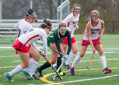 AMANDA SABGA/Staff photo   Manchester Essex's Christina Bullock tries to keep the ball as she is swarmed by Watertown defenders during the division two north field hockey championship game against Watertown at North Andover High School. Manchester Essex was defeated by Watertown 1-0.  11/10/18