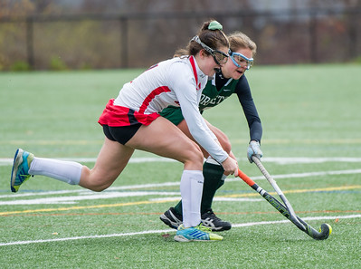 AMANDA SABGA/Staff photo   Manchester Essex's Christina Bullock fight for the ball from Watertown's Catherine Connors (7) during the division two north field hockey championship game against Watertown at North Andover High School. Manchester Essex was defeated by Watertown 1-0.  11/10/18
