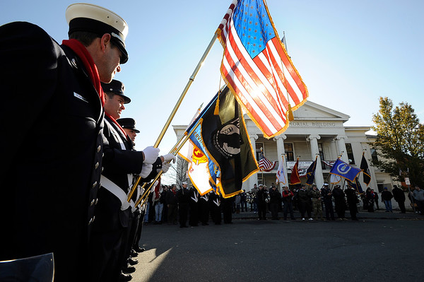 "The Fire Fighters color guard stand at the WWI Joan of Arc Monument by the American Legion building during the Gloucester Veterens Day WWI Ceremony to honor the Gloucester soldiers who died during the ""Great War"" and remember the Armistice that was signed by the Allies and Germany 100 years ago to end the war on Sunday November 11, 2018.  Photo by Joseph PREZIOSO"