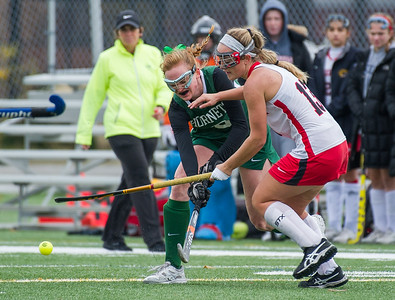 AMANDA SABGA/Staff photo   Manchester Essex's Annika Dahlin (8) fights off Watertown's ALly Kennedy (13) during the division two north field hockey championship game against Watertown at North Andover High School. Manchester Essex was defeated by Watertown 1-0.  11/10/18