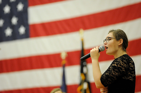 Sadie Cook sings America the Beautiful with the Docksiders during the Gloucester Veterens Day Ceremony and Parade on Sunday November 11, 2018.  Photo by Joseph PREZIOSO