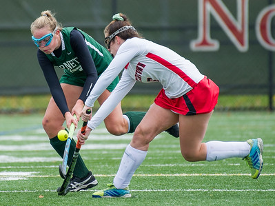 AMANDA SABGA/Staff photo   Manchester Essex's Anna Coyne (13) scuffles with Watertown's Catherine Connors (7) during the division two north field hockey championship game against Watertown at North Andover High School. Manchester Essex was defeated by Watertown 1-0.  11/10/18