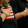 Coleen Plummer holds her and over her heart during the Pledge of Allegiance during the Gloucester Veterens Day Ceremony and Parade on Sunday November 11, 2018.  Photo by Joseph PREZIOSO