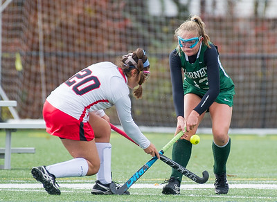 AMANDA SABGA/Staff photo   Manchester Essex's Anna Coyne (13) fights Watertown's Christina Zovein (20) for the ball during the division two north field hockey championship game against Watertown at North Andover High School. Manchester Essex was defeated by Watertown 1-0.  11/10/18