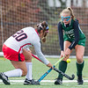 AMANDA SABGA/Staff photo <br /> <br /> Manchester Essex's Anna Coyne (13) fights Watertown's Christina Zovein (20) for the ball during the division two north field hockey championship game against Watertown at North Andover High School. Manchester Essex was defeated by Watertown 1-0.<br /> <br /> 11/10/18