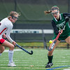 AMANDA SABGA/Staff photo <br /> <br /> Manchester Essex's Natalie Koopman (17) deflects a pass by  Watertown's Ellie Monahan (3) during the division two north field hockey championship game against Watertown at North Andover High School. Manchester Essex was defeated by Watertown 1-0.<br /> <br /> 11/10/18