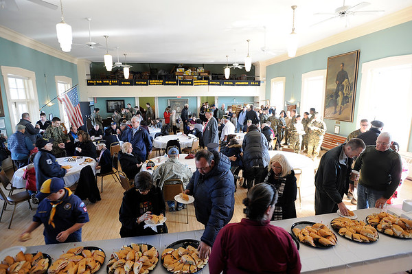 """Community members enjoy lunch at the American Legion building after the Gloucester Veterens Day WWI Ceremony to honor the Gloucester soldiers who died during the """"Great War"""" and remember the Armistice that was signed by the Allies and Germany 100 years ago to end the war on Sunday November 11, 2018.  Photo by Joseph PREZIOSO"""