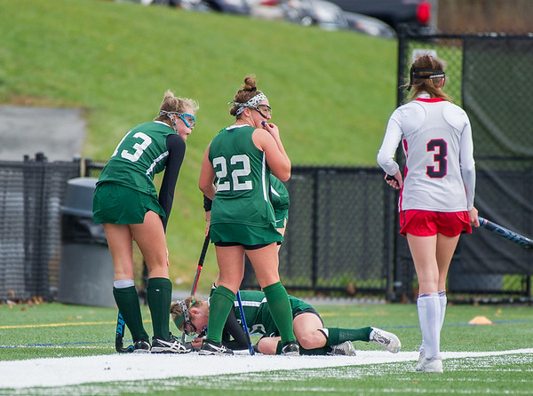 AMANDA SABGA/Staff photo <br /> <br /> Manchester Essex's Suzanne Morton (5) down from a tackle during the division two north field hockey championship game against Watertown at North Andover High School. Manchester Essex was defeated by Watertown 1-0.<br /> <br /> 11/10/18