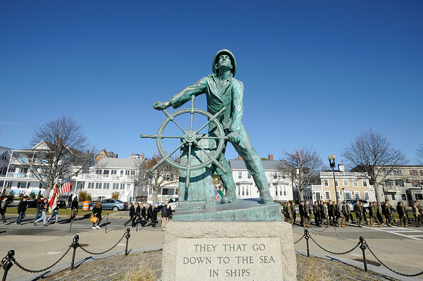 Parade participants march by the Fishermen's Memorial during the Gloucester Veterens Day Ceremony and Parade on Sunday November 11, 2018.  Photo by Joseph PREZIOSO
