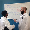 SEAN HORGAN/Staff photo<br /> Instructor Mark Gasser discusses the day's lab work with student Rey Monciora of Lawrence.