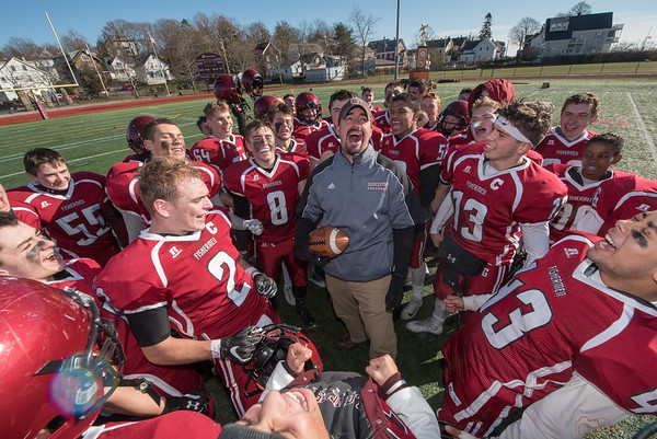 Desi Smith Photo.   Gloucester's head coach Tony Zerilli celebrates with his team after their Thanksgiving Day win over Danvers Thursday at the New Balance Track and Field at Newell Stadium.     November 23,2017 [[MER1711231502442203]]