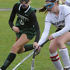 TIM JEAN/Staff photo<br /> <br /> Rockport's Mariah Colbert battles against Manchester Essex's Suzy Morton during a field hockey game at Rockport High School. 10/24/18