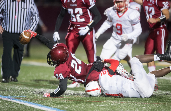 Desi Smith Photo.       Gloucester's Jan Pena Ortiz (28) stretches to put the ball over the goal line, but comes up just short, in the first quarter against Melrose Friday night at New Balance Track and field at Newell Stadium.     October 26,2018