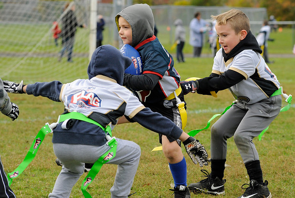 Max Curcuru is stooped as George Karvelas pulls on his flag during Gloucester's Flag Football League games at O'Maley Field on Sunday October 21, 2018.  Photo by Joseph Prezioso