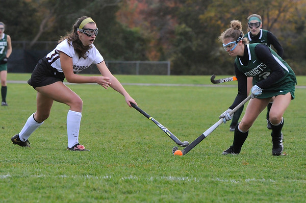 TIM JEAN/Staff photo<br /> <br /> Rockport's Taylor Frost, left, tries to stop Manchester Essex's Christina Bullock during a field hockey game at Rockport High School. 10/24/18