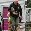 Desi Smith photo. Masssachusetts State Police Sgt. Robert Bachelder a hazardous device technician, removes a 75 caliber shell from a home on Bond Street in Gloucester on Monday morning.  October 15, 2018