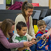 AMANDA SABGA/Staff photo <br /> <br /> Isaiah Hiciano feels the skin a California king snake during a visit from Curious Creatures at the Veterans' Memorial School in Gloucester. <br /> <br /> 10/23/18