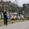 TIM JEAN/Staff photo<br /> <br /> A jogger runs on the sidewalk next to the ocean near the Gloucester Fisherman Statue Wednesday afternoon.  10/24/18