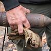 Desi Smith Photo. Masssachusetts State Police Sergeant, Robert Bachelder a hazardous device technician removes a 75 caliber shell from a home on Bond Street Monday morning.  October 15, 2018