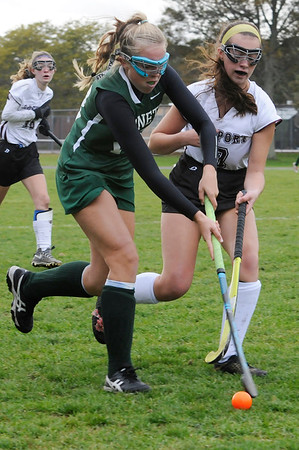 TIM JEAN/Staff photo<br /> <br /> Rockport's Taylor Frost, right, tries to stop Manchester Essex's Anna Coyne during a field hockey game at Rockport High School. 10/24/18