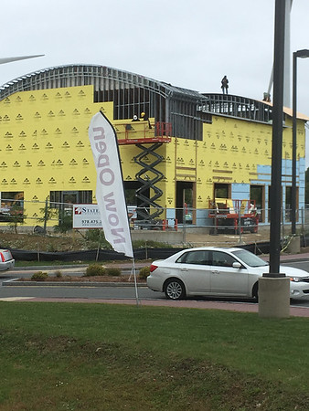 ANDREA HOLBROOK/Courtesy photo/Columbus Day wasn't a holiday for workers constructing the Aspen Dental building at Gloucester Crossing on Monday.