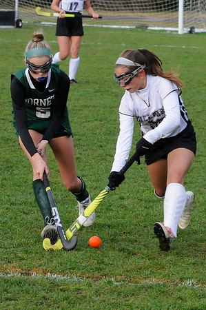 TIM JEAN/Staff photo<br /> <br /> Manchester Essex's Suzy Morton, left, stops Rockport's Tess Campbell as she brings the ball up field during a field hockey game at Rockport High School. 10/24/18