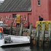 TIM JEAN/Staff photo<br /> <br /> A shipmate of the Mary Marjorie, of Rockport loads lobster traps along the dock before they head out Wednesday afternoon. 10/24/18
