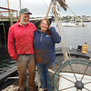 SEAN HORGAN/Staff photo/Essex shipwright Harold Burnham, left, and project partner Mary Kay Taylor, at the stern of the Silvina W. Beal on Monday, plan to renovate the 107-year knockabout schooner.