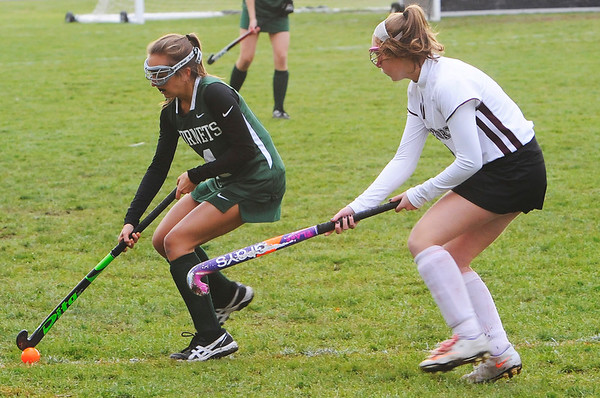TIM JEAN/Staff photo<br /> <br /> Rockport's Lucy Twombly, right, tries to stop Manchester Essex's Clair Genaron during a field hockey game at Rockport High School. 10/24/18