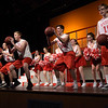 TIM JEAN/Staff photo<br /> <br /> The Jocks, sing and dance on stage to the song Get My Head in the Game, during a dress rehearsal for Disney's High School Musical in the Lane Performing Arts Center at Rockport High School. 10/24/18
