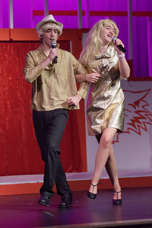 TIM JEAN/Staff photo<br /> <br /> Alex Strzemilowski, left, and Hattie Mae Rich, sing and dance on stage during a dress rehearsal for Disney's High School Musical in the Lane Performing Arts Center at Rockport High School. 10/24/18