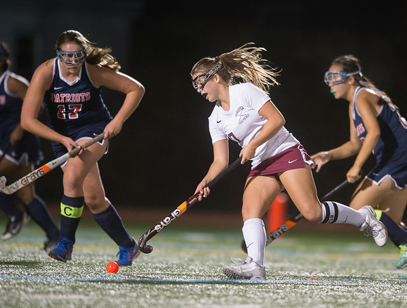 Desi Smith Photo.  Gloucester's Rachel Alexander (7) pushes the ball past Revere's Samantha Woodman (17) during their match up at Newell Stadium Wednesday night. October 19,2016