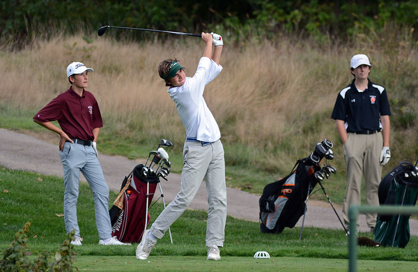 RYAN HUTTON/ Staff photo<br /> Manchester Essex's Clayton Booma, 16, tees off at the fourth hole of the Essex Country Club during the Old Cape Ann Classic on Thursday. At left is Rockport's Bowen Slingluff, 13, and at right is Ipswich's Bobby Grady, 15.